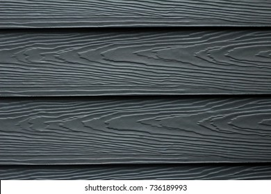 Close up dark blue or navy color wood substitute board and high quality fiber cement board for architect, Beautiful wood plank texture and background patterns for design, cement striped wood wall