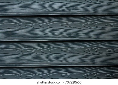 Close up dark blue wood substitute board and high quality of fiber board  texture and background for design and architect, Beautiful wooden plank patterns from cement striped wood wall