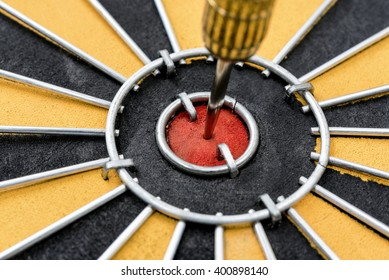 Close up dart target with arrow hitting on bullseye in dartboard, Smart goal setting and marketing  business concept, abstract background
