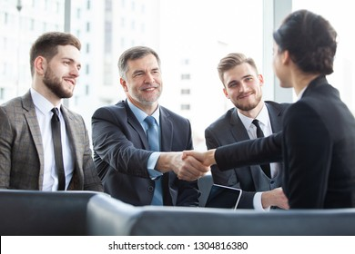 Close the deal. Great job! Business people shaking hands, finishing up a meeting
