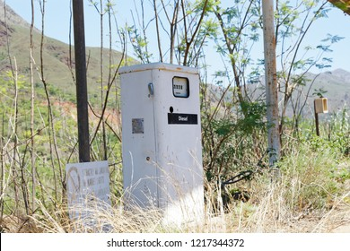 Close up of decommissioned Petrol Pump in high grass.Msauli Village was developed in 1940s. The asbestos mine closed 2001 and the village was consequently abandoned.Over the years it got vandalised.