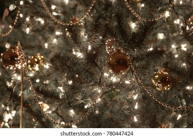 Close up of a decorated christmas tree at night.