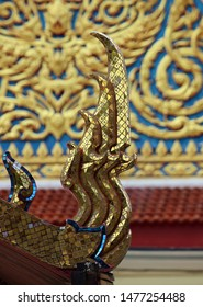 Close up of the decorative architectural details on the eaves of a Thai Buddhist temple roof