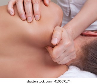 Close up of deep tissue and sport massage on neck and shoulder