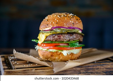 Close up delicious fresh burger on wooden board