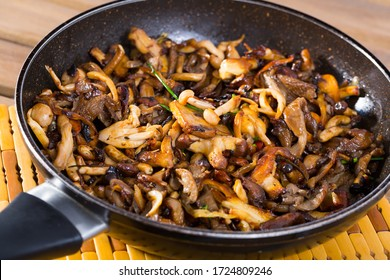 Close up of delicious freshly cooked fried shitake mushrooms in a frying pan