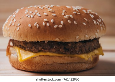Close up of a delicious hamburger on wooden background