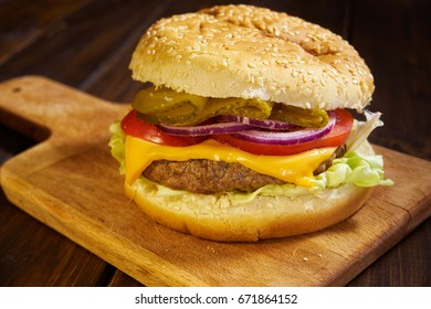 Close up of delicious home made hamburger in rustic style on wooden background