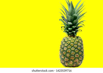 Close up of delicious pineapple on yellow background