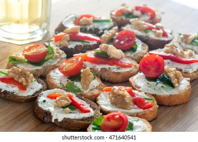 Close up of a delicious tapas food with yogurt, cheese, tomatoes walnuts and red peppers