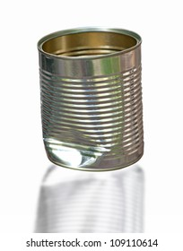 Close up of dented tin can isolated on white