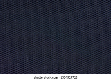 Close up department color cotton fabric texture background. Dark blue textured knit. Selective focus. top view.