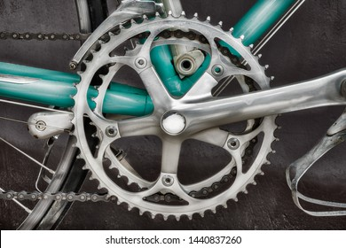 Close up of the derailleur of a vintage seventies light blue racing bicycle