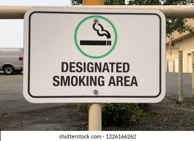 Close up of designated smoking area sign