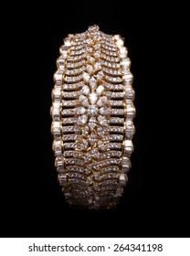 Close up of designer diamond bracelet having many diamonds over black background