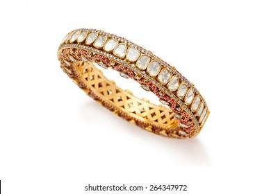 Close up of designer gold and diamond bangle