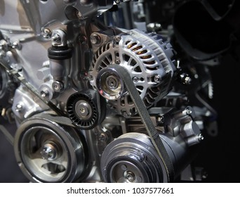 Close up detail of an automotive engine on display at an auto show.