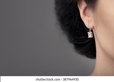 Close up Detail of a Beautiful Earring in Glamour Shot - Image of a beautiful precious piece of jewel hanging from ear