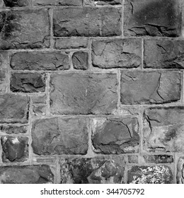 Close up detail in black and white of a stone/brick wall (medium format B&W film).