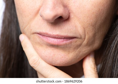 Close up detail of the chin of a middle-aged woman without makeup. High quality photo