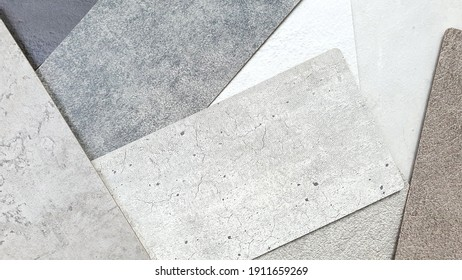 close up detail of concrete laminated samples in grey color tone. interior wall or furniture finishing material samples in various texture and color. abstract rustic loft cement background.