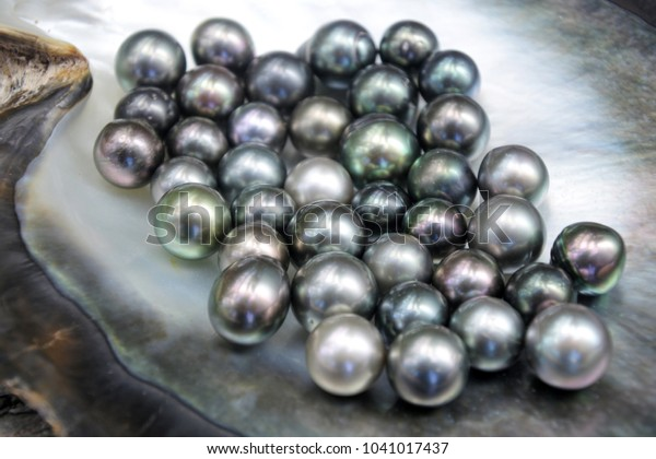 Close up detail of excellent round Tahitian Black Pearls.
