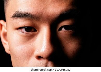 Close detail of the eye of an asian man. Asian people concept
