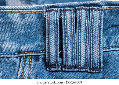 Close up detail four belt loops on blue jeans