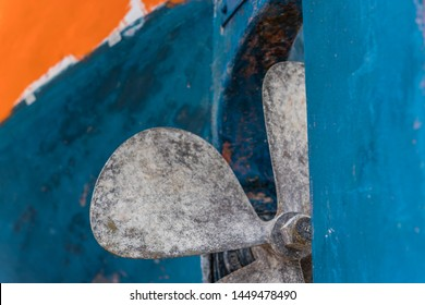 Close up detail of a four blades fisherman boat propeller in port, Zante, Greece