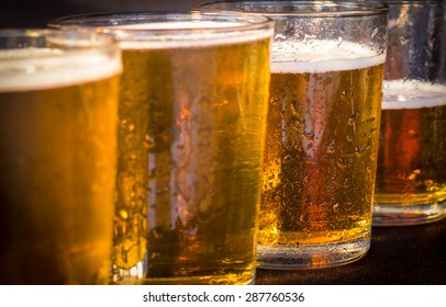 Close up detail of glasses of beer