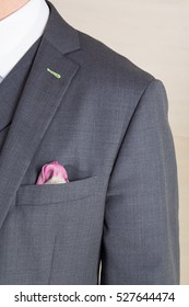 Close up detail of  a grey tailored business suit with pocket and hankerchief