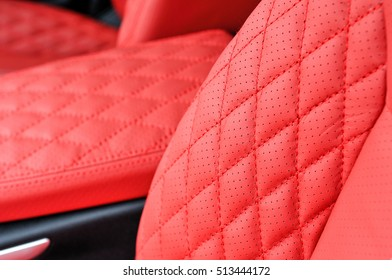 close detail of a luxury red leather interior in a prestige car