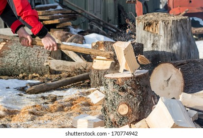 close up detail of man breaking fire wood