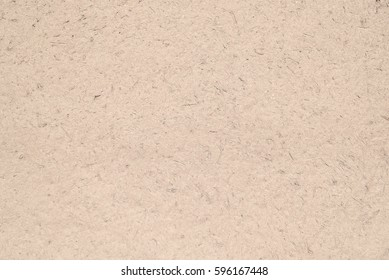close up detail of old beige brown stucco clay wall, abstract rough surface for background, backdrop or design element in architectural material concepts
