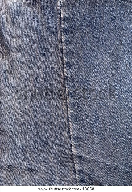 Close detail of old denim jeans