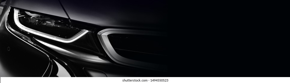 Close up detail on one of the LED headlights modern car.copy space