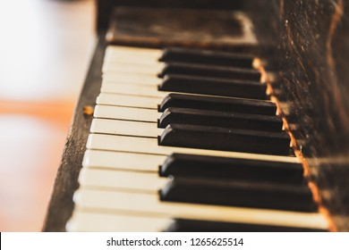 Close up detail of piano keyboard on an old upright piano.