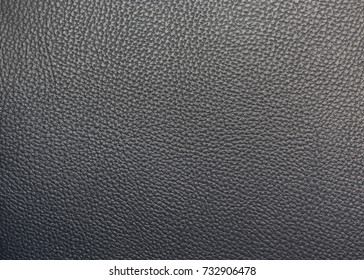 Close up detail seamless black leather surface texture background