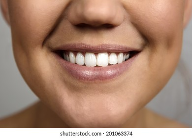 close up detail shot of a beautiful woman's mouth smiling