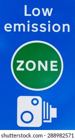 Close up detail of a signal indicating the limit of low emission traffic zone in London, United Kingdom, with camera tutor for violations and fines.
