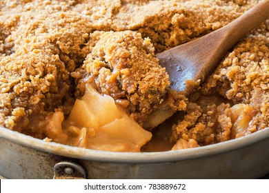 Close Up Detail of Spoonful of Apple Crisp or Apple Crumble, a Baked Fruit Dessert with Brown Sugar Topping