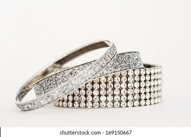 Close up detail still life view of exclusive and luxurious diamond bracelets engagement rings. A multiple quality diamond detail shining and sparkling with light, interior.