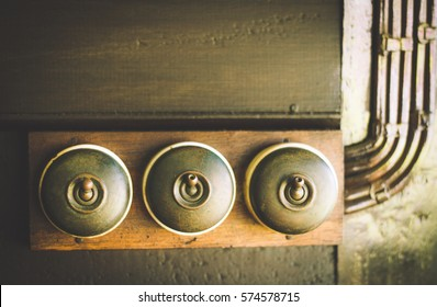 Close up of detail of a very old light switch on old wood texture backgrounds