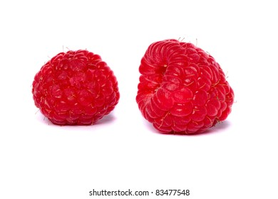 Close detail view of some raspberry isolated on a white background.