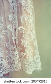 Close up detail of vintage style wedding dress on a hanger