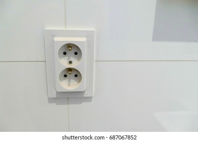 a close detail of a white electric socket