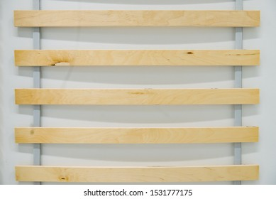 Close up detail of wooden elements double bed slatted mattress base.
