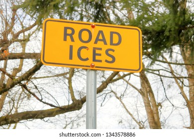Close, detailed look at a sign that warns motorists that the road can become icy.