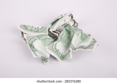 Close up detailed top view of crumpled one hundred dollar banknotes, isolated on white background.