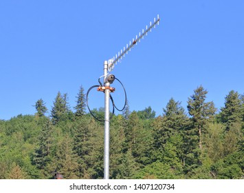 Close detailed view of a high powered and small communications antenna used for transmitting radio frequencies in remote areas.